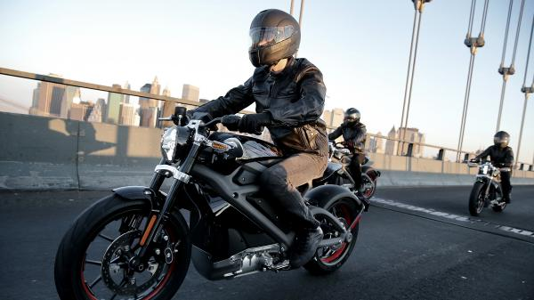 Harley-Davidson riders reveal Project LiveWire, the first electric Harley-Davidson motorcycle, during a ride across New York City's Manhattan Bridge on June 23.