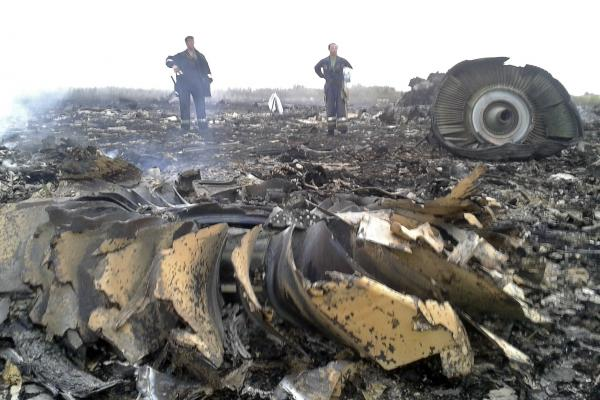 "Ukrainian President Petro Poroshenko said evidence from the crash must remain in place until investigators can look into ""all aspects of the tragedy."""