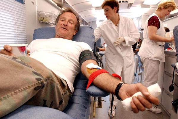Williams donates blood on Sept. 11, 2001, at the Irwin Memorial Blood Center in San Francisco.