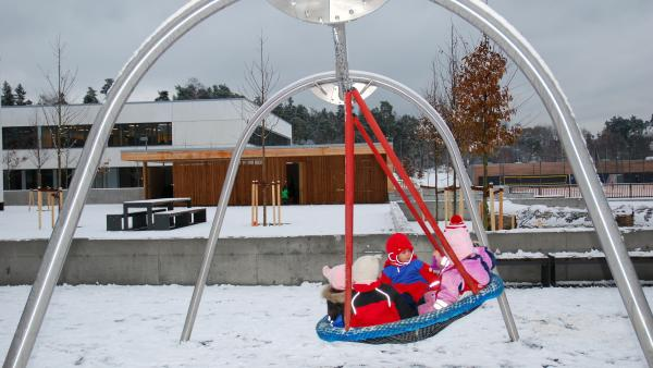 Children play outside at a day care center in Norway. Kids play outdoors, and take naps, even when it's extremely cold.
