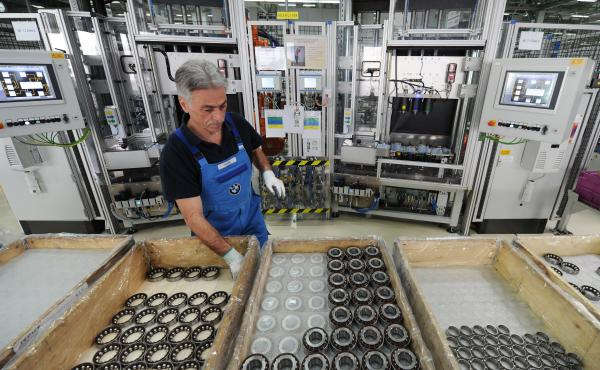 An employee works at the axle gear production line at a BMW plant in Dingolfing, southern Germany, on March 23, 2012. This BMW plant installed special ergonomic workspaces to help its rapidly aging workforce — a trend that's reflected in Germany's economy as a whole. That's one reason why critics oppose a new move to lower the country's early retirement age.