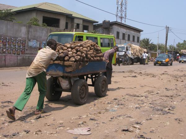 Boys push heavily loaded carts through Agbogbloshie, the same job performed by <em>Children of the Street</em>'s first murder victim.