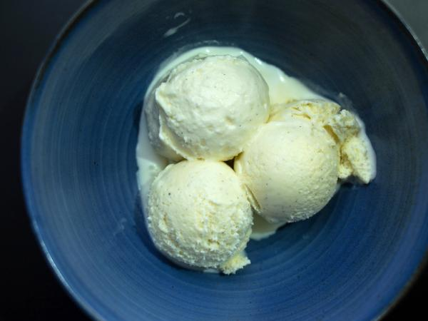 Three scoops of vanilla ice cream made with vanilla beans from Mexico, Tahiti and Madagascar.