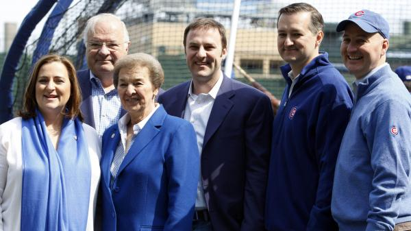 The Ricketts family poses on the Chicago Cubs field in 2010, a year after they bought the team: Laura Ricketts (from left), Joe Ricketts, Marlene Ricketts, Todd Ricketts, Tom Ricketts and Pete Ricketts.