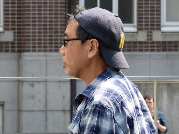Publicity-shy Japanese author Haruki Murakami arrives to give a public lecture in Kyoto in May 2013.