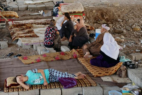 Displaced Iraqis from the Yazidi community settle under a bridge in central Dahuk, Aug. 14. Human rights activists say evidence of the Islamic State's violence against the Yazidis points to war crimes, and amounts to ethnic cleansing.