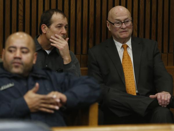 Theodore Wafer (center) and his attorney Mack Carpenter sit in the back of the courtroom Jan. 15 before his arraignment in Detroit in the shooting death of Renisha McBride.