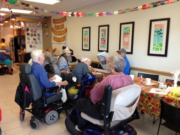 Patients at the monthly birthday celebration at the Wellness Center.