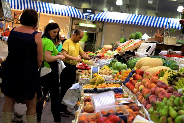 Customers shop for produce at the Danilovsky Market in Moscow. The food import ban prevents the import of almost all fresh food from the U.S., Europe and other Western countries. What's left in the market is grown locally or by Russian allies.