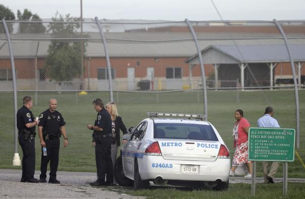 Police work in front of the Woodland Hills Youth Development Center on Tuesday in Nashville, Tenn.