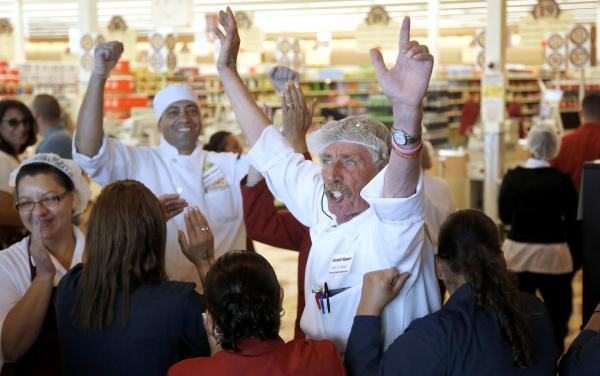 Market Basket meat manager Bob Dietz of Methuen, Mass., (center) and other workers celebrate after watching a televised speech last month by restored Market Basket CEO Arthur T. Demoulas at a store in Chelsea.