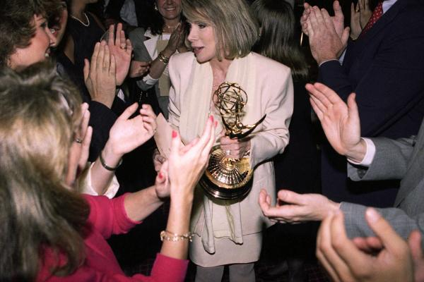 Fans congratulate Rivers after she won the Emmy for outstanding talk show host in 1990. Rivers, host of <em>The Joan Rivers Show</em>, dedicated her Emmy to her late husband.