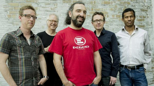 Stefano Bollani (center) and the musicians who back him on the new album <em>Joy in Spite of Everything</em>. From left: Mark Turner, Bill Frisell, Jesper Bodilsen, Morten Lund.