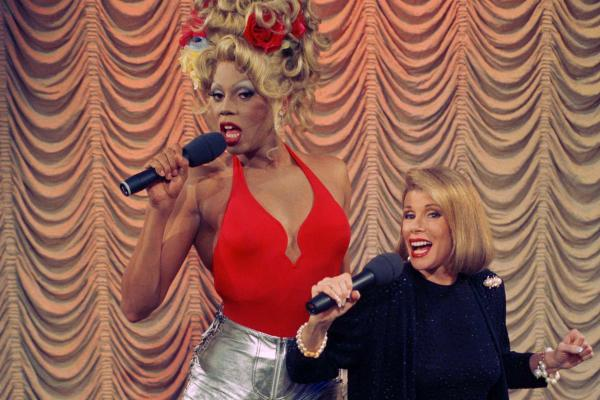 "RuPaul sings a number from his debut album ""Supermodel of the World"" with Rivers during taping of <em>The Joan Rivers</em> <em>Show</em> in 1993."