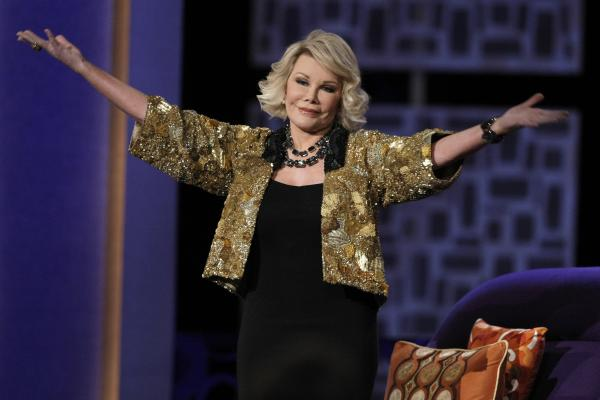 "Joan Rivers greets the audience at the ""Comedy Central Roast of Joan Rivers"" in 2009. She died Thursday at 81."