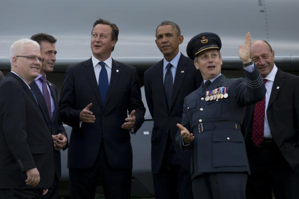 President Obama stands alongside British Prime Minister David Cameron, center left, NATO Secretary General Anders Fogh Rasmussen, second left, Croatian President Ivo Josipovic, left, Romanian President Traian Basescu, right, and RAF Group Captain David Bentley, second right, during a flypast at the NATO summit at the Celtic Manor Resort in Newport, Wales on Friday.