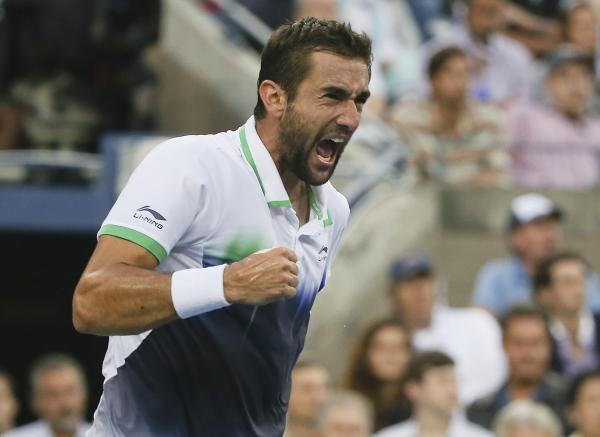 Marin Cilic of Croatia reacts after a shot against Kei Nishikori of Japan during the championship match of the 2014 U.S. Open tennis tournament. Cilic won in three sets.
