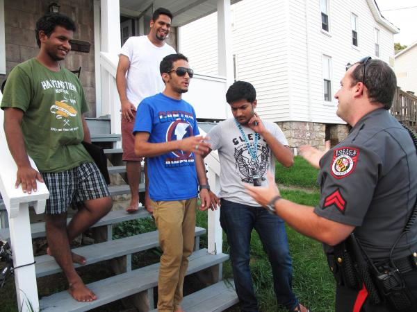 "Frostburg State University police officer Derrick Pirolozzi conducts a ""knock and talk"" at a house near campus, reminding students of laws on underage drinking and open containers."