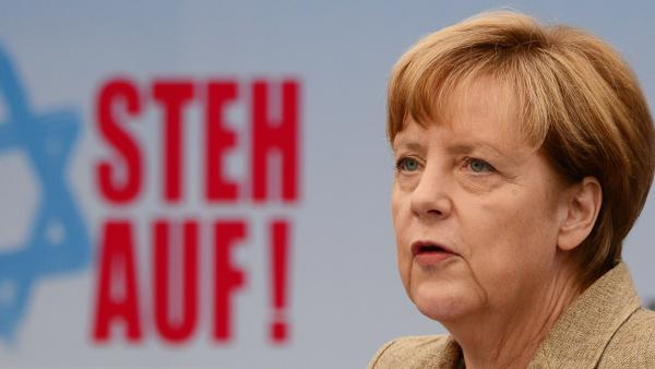 """German Chancellor Angela Merkel addresses a rally against anti-Semitism titled """"Stand Up! Jew Hatred - Never Again!"""" in Berlin."""