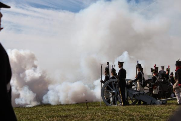 Re-enactors fired blank charges, clouding the hillside with white smoke.