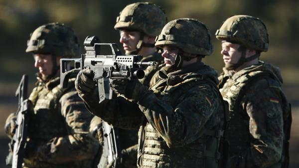 Soldiers of the Bundeswehr, the German army, present their Heckler & Koch G36 assault rifles during military exercises in 2013. Heckler & Koch is headquartered in Oberndorf, where many residents worry that their jobs will be at risk if Germany cuts back on arms shipments. Critics, meanwhile, point out that Heckler & Koch weapons are carried by the Taliban as well as by the Bundeswehr.