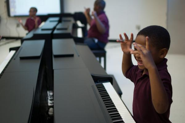 Before they can touch the piano keys, kids must do finger exercises