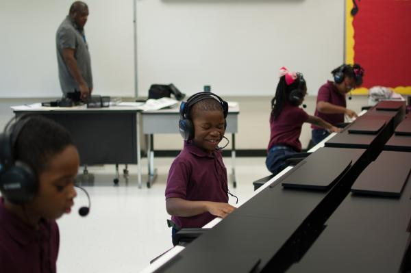 The headsets allow the instructors to speak directly to one student or a group of students .