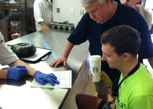 Cory Remsburg looks over a menu from the new American Heroes Cafe at James A. Haley VA Hospital.