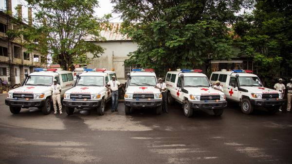 Five ambulances, donated by the U.S. to help combat Ebola, are lined up after a ceremony attended by Sierra Leone's president, Ernest Bai Koroma, in Freetown on Sept. 10.