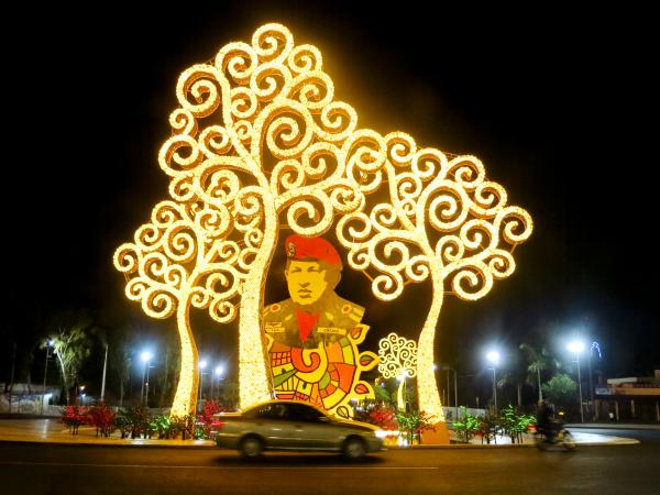 A tribute to Venezuela's late President Hugo Chavez sits at Simon Bolivar Boulevard in downtown Managua, Nicaragua. The Venezuelan government sends hundreds of millions of dollars annually to Nicaragua. The metal trees were designed by Nicaragua's first lady, Rosario Murillo.
