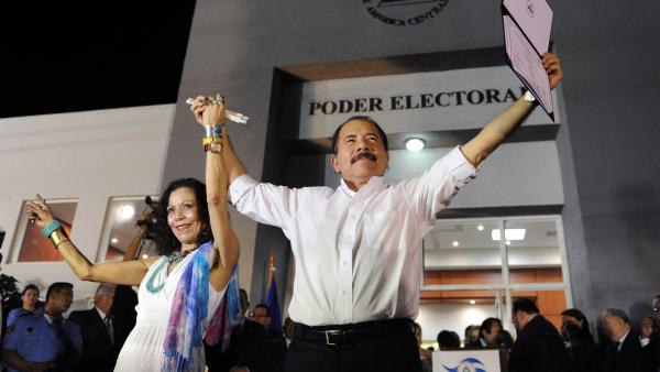 Nicaraguan President Daniel Ortega celebrates with first lady Rosario Murillo a day before his re-inauguration in 2012.
