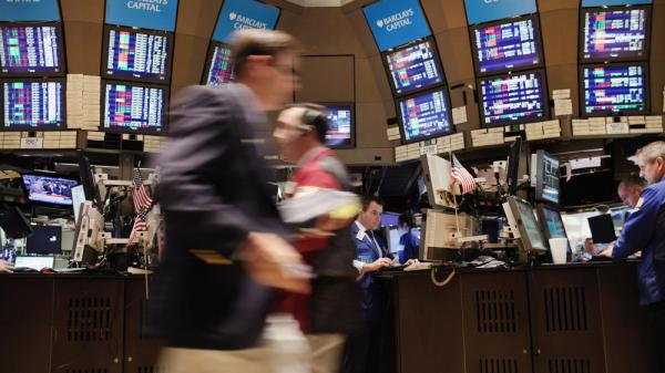 Traders work on the floor of the New York Stock Exchange during morning trading on Thursday.