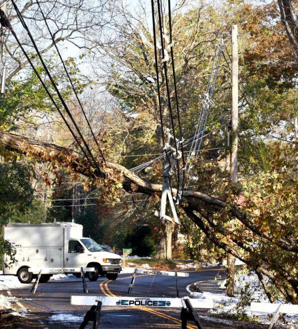 <p>Monday: Downed power lines in North Andover, Mass. </p>