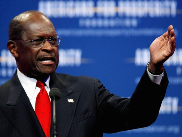 Republican presidential candidate Herman Cain addressed the Defending the American Dream Summit at the Washington Convention Center Nov. 4. in Washington, DC. He plans to speak about the sexual harassment allegations against him at a news conference Tuesday afternoon.