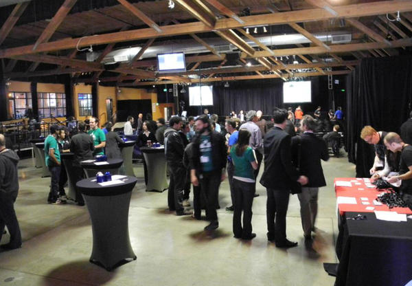 A crowd mills at Demo Day for the technology incubator TechStars in Seattle, where a group of startups presented their pitches to investors. Marketing firm Bluebox Now pitched their product at Demo Day, but faces tough decisions about their future.