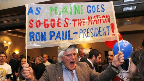 Ken Kroesser shows his support for Ron Paul during a caucus night party Feb. 11 in Portland, Maine.