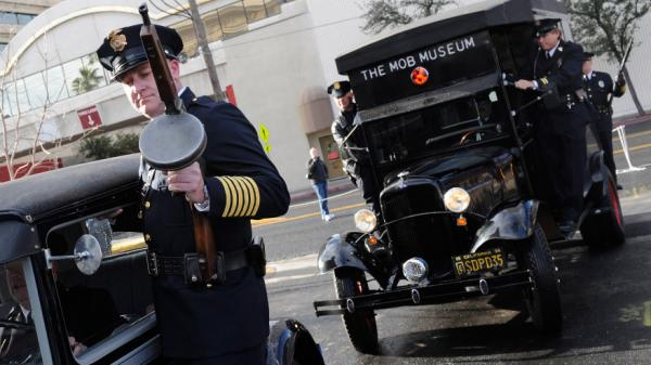 <strong>Look Out, Copper:</strong> A 1928 Ford Model A car (left) and a 1938 Ford paddy wagon arrive at the Feb. 14 grand opening of The Mob Museum in Las Vegas.