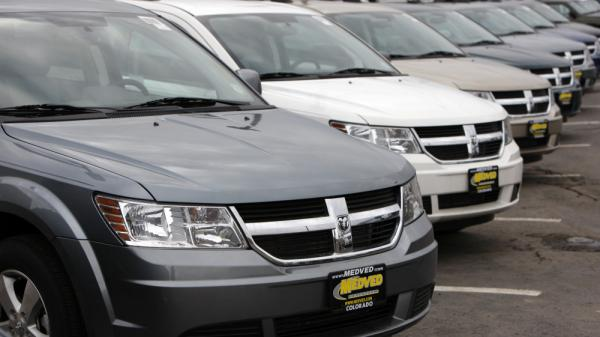 Growing demand for more fuel-efficient cars and trucks, like these 2009 Dodge Journey crossover vehicles, has helped drive down gasoline consumption in the U.S.