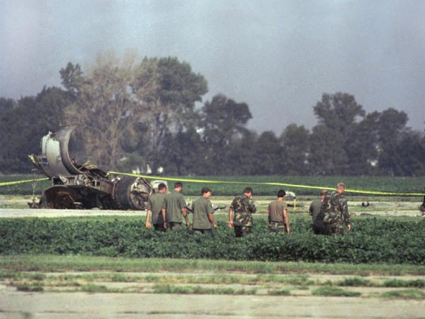 Iowa Air National Guard soldiers search a field near wreckage from the crash landing at the airport in Sioux City, Iowa.