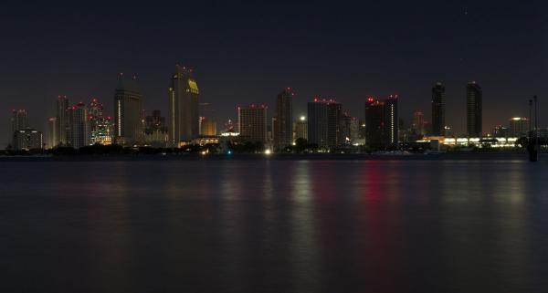 The eerie blackness of San Diego's skyline is punctuated only by the glimmers of warning lights and emergency lights.