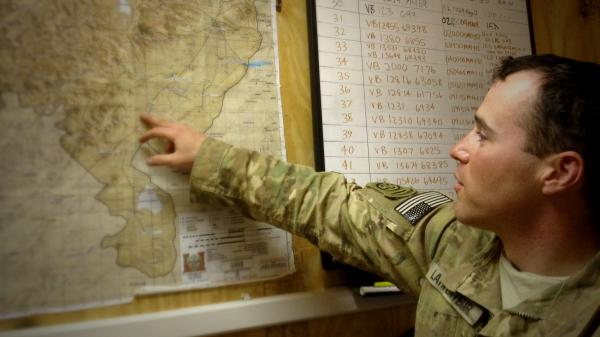 Capt. Jared Larpenteur plans a combat mission at the 82nd Airborne's Delta Company command center in Ghazni province, Afghanistan, earlier this year.