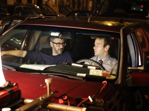 Ira Glass (left) and Mike Birbiglia collaborate on the set.