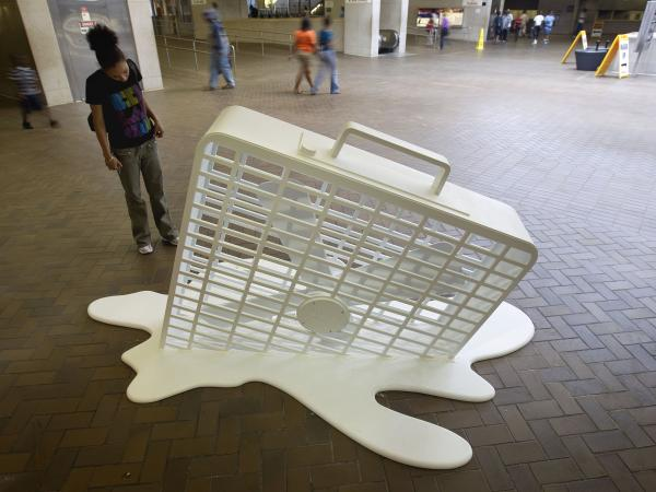 An art installation of a melting fan sits on display in a subway station Thursday, June 9, 2011, in Atlanta.