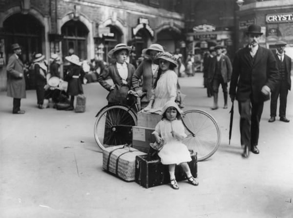 A party of holidaymakers waits for a train at Waterloo station in London, in July 1913.