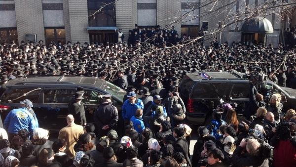 Mourners lined the street Sunday outside a synagogue in Brooklyn where funeral services were held for Raizy and Nathan Glauber.