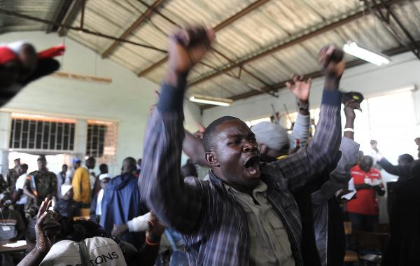 A supporter celebrates on March 6, 2013 at a polling station in the Mathare slum of Nairobi.
