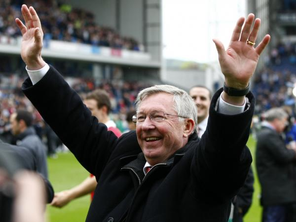 Manchester United manager Alex Ferguson celebrates after his team wins the English Premier League at Blackburn, England, on May 14, 2011.