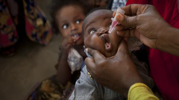 A baby receives a polio vaccine at the Medina Maternal Child Health center in Mogadishu, Somalia. The country has one of the lowest immunization rates  in the world.