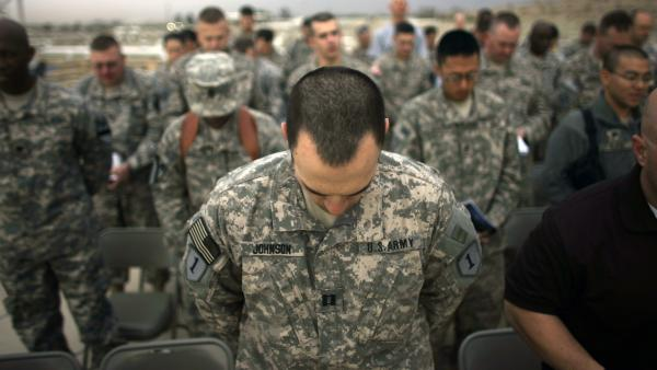 There has been a recent push for humanist chaplains in the United States military. Around 13,000 active service members are atheist or agnostic. Here, U.S. Army soldiers bow their heads in prayer during Easter sunrise service at Camp Liberty in Iraq, in 2009.