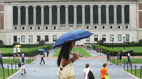 For the first time, a majority of students got federal help to attend college, according to a new U.S. survey. Here, people walk on the Columbia University campus in July.